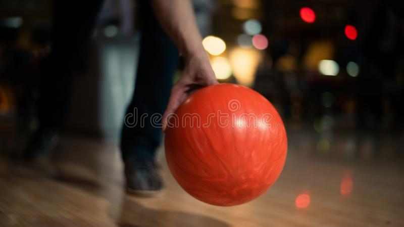 Bowling ball. Man is pushing a bowling ball stock images