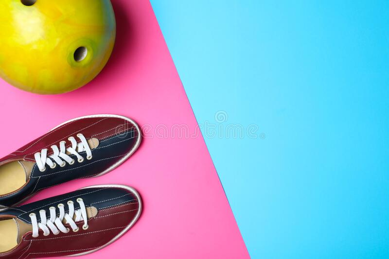 Bowling ball and shoes on color background. Space for text. Bowling ball and shoes on color background, flat lay. Space for text royalty free stock image