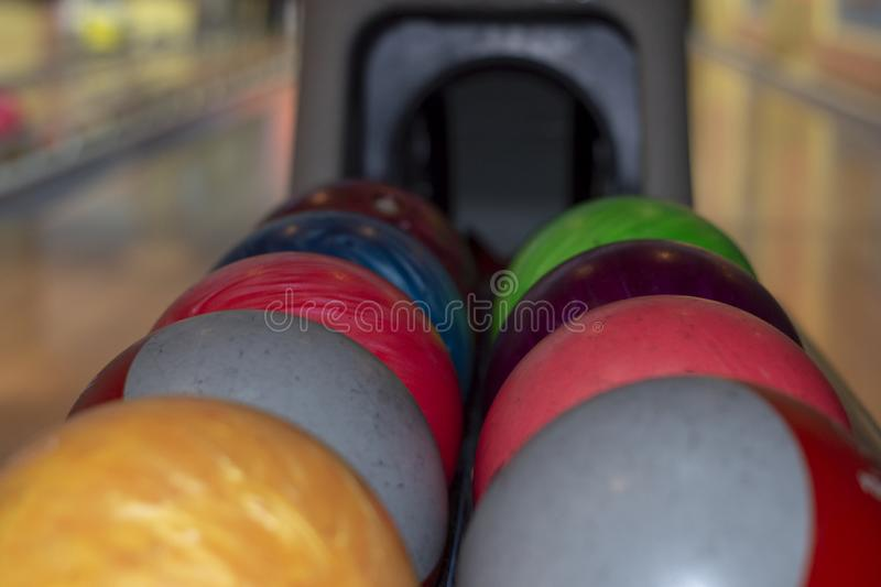 Bowling balls on the rack. Holiday royalty free stock photos