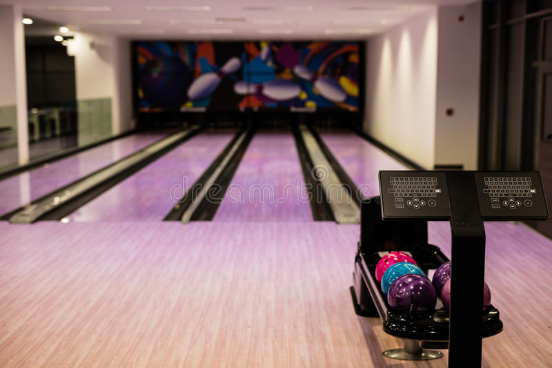 Bowling balls. And wooden lane in bowling hall stock photography