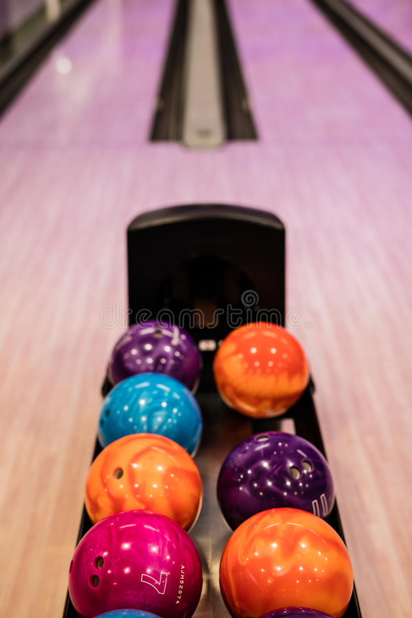 Bowling balls. And wooden lane in bowling hall royalty free stock images
