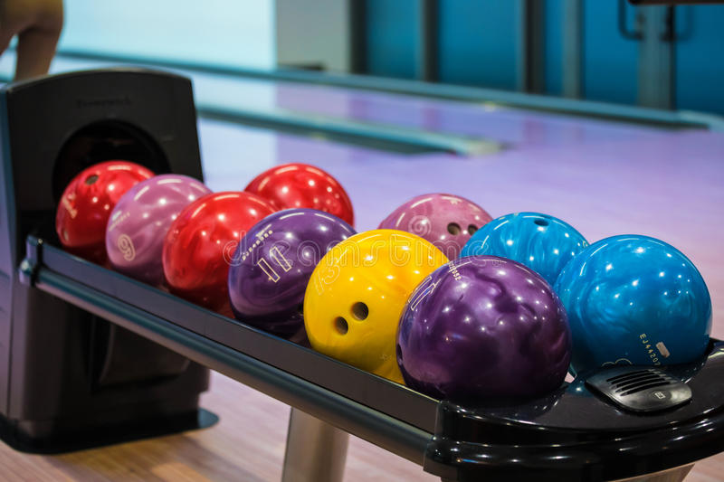 Bowling balls. And wooden lane in bowling hall stock images
