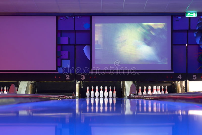 Bowling center. Blue track in a bowling center stock photography