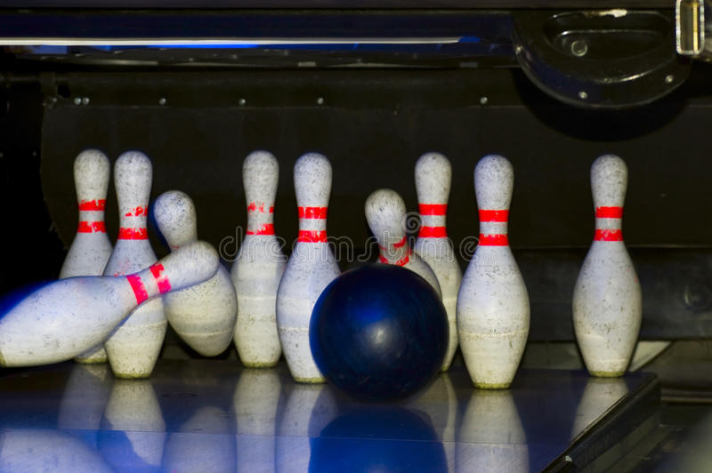 Bowling game. Bowling pins on an alley stock photography