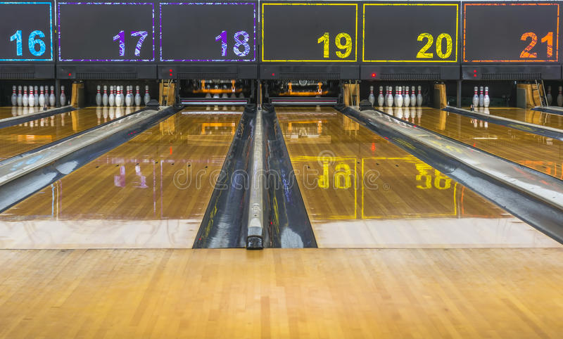 Bowling lane. Shining bowling lane with wooden floor stock images