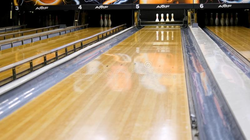 Bowling pins fly to the sides of a ball. Media. Bowling ball smashes the pins.  stock photography