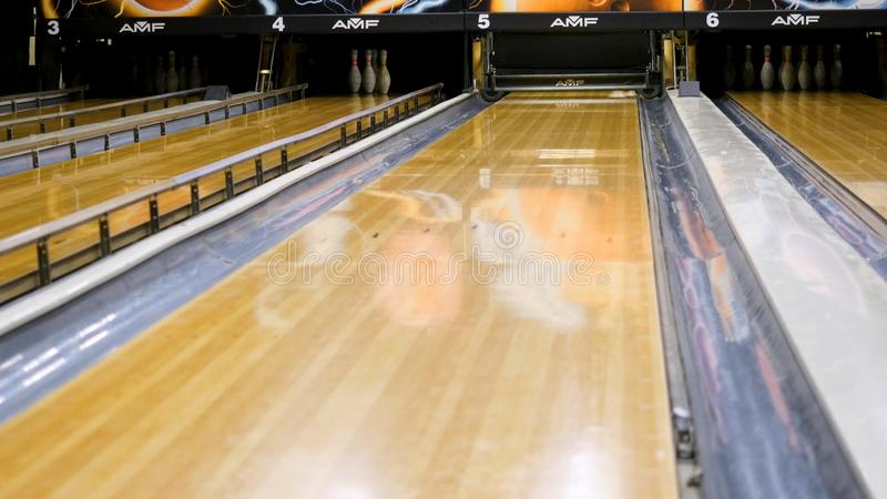 Bowling pins fly to the sides of a ball. Media. Bowling ball smashes the pins.  royalty free stock photo