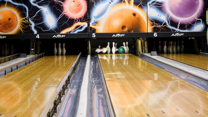 Bowling pins fly to the sides of a ball. Media. Bowling ball smashes the pins.  royalty free stock images