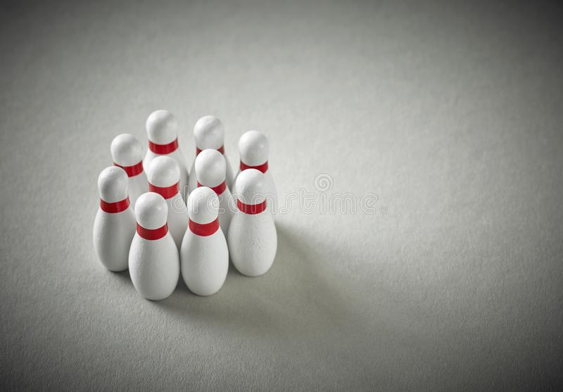 Bowling pins on grey background royalty free stock images