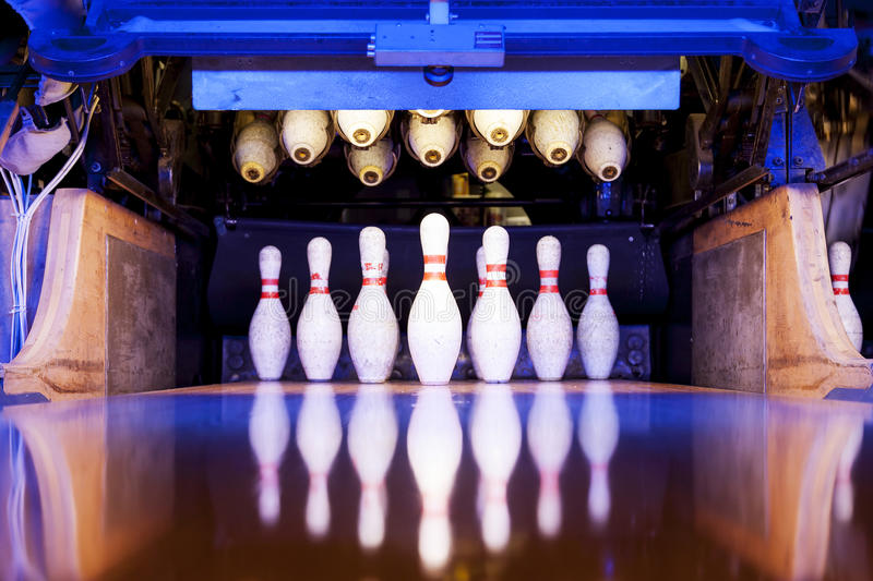 Bowling pins ready to be felled. On the track royalty free stock photo