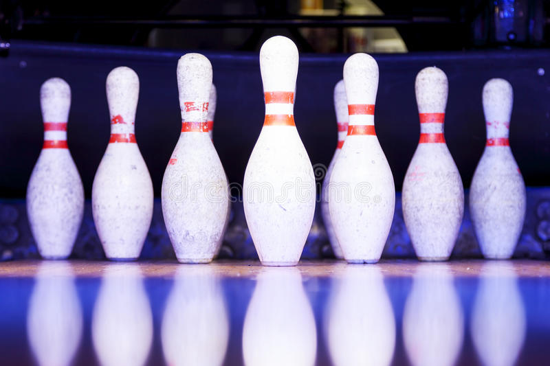 Bowling pins ready to be felled. On the track stock images