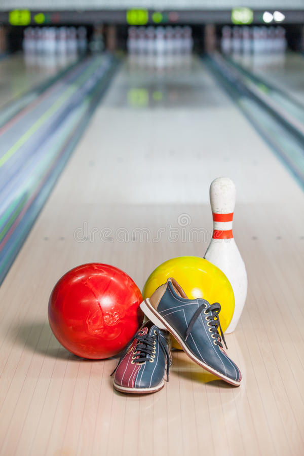 Bowling Shoe. Bowling shoes and two bowling balls on the lane stock photography