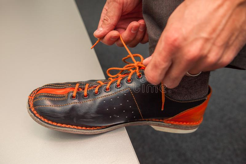 Bowling shoes in action with a game of bowling. In sports center stock images