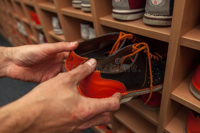 Bowling shoes in action with a game of bowling. In sports center royalty free stock image