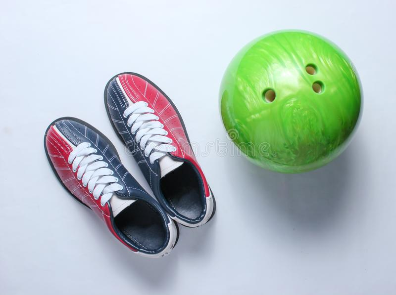 Bowling shoes and bowling ball. On white background. Indoor family sports. Top view. Minimalism stock photos