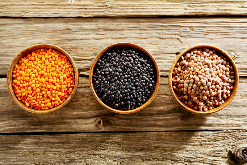 Bowls of assorted dried lentils stock photo