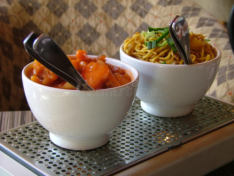 Bowls with chinese food royalty free stock images