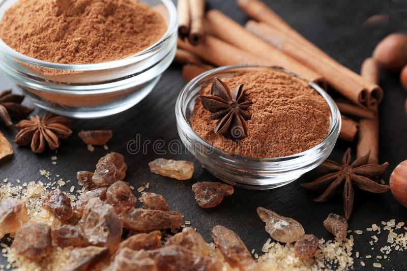 Bowls with cinnamon powder and sugar on table, closeup stock photography