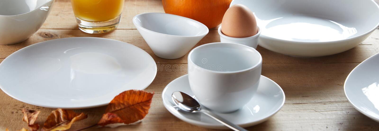 Bowls and cup of white ceramic for breakfast royalty free stock image