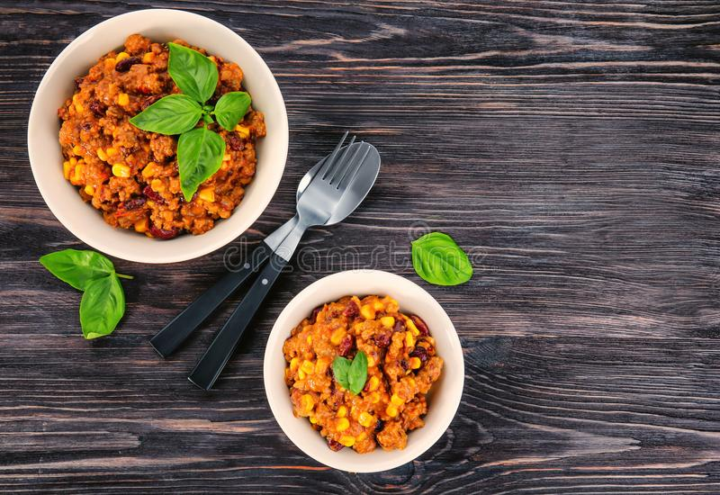 Bowls with delicious chili con carne royalty free stock image