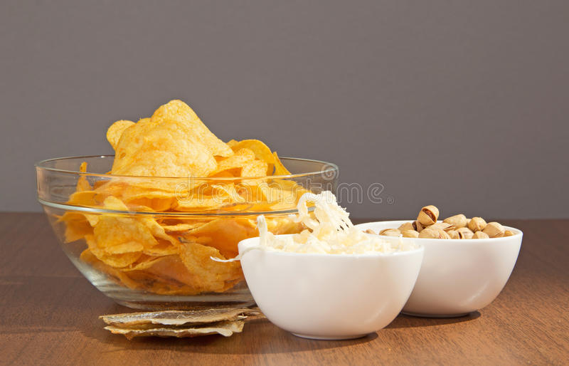 Bowls with snack to beer. On a gray background royalty free stock images