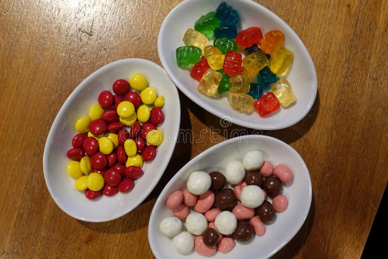 Three Bowls of tasty candy stock image