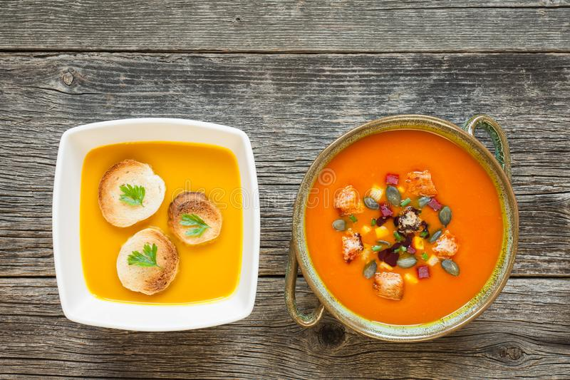 Bowls with vegetarian soup on an old wooden table royalty free stock images