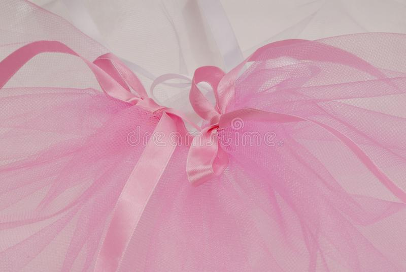 Bows and bridal veil, pink and white kapron veil royalty free stock photography