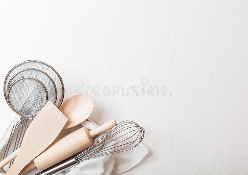 Box of baking utensils. Whisk, mesh and spatula in vintage wooden box.Top view. Space for text. Box of baking utensils. Whisk, mesh and spatula in vintage wooden stock photography
