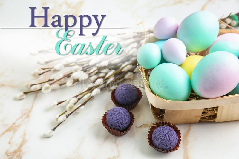 Box with beautiful Easter eggs and pussy willow on light background stock image