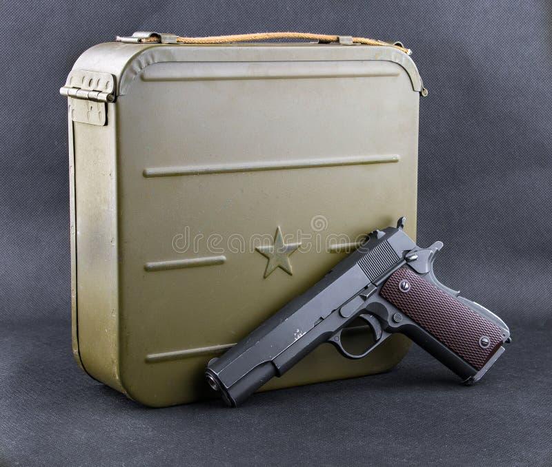 Box for bullets and a gun stock photos