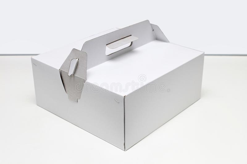 Box for Cake. Big White Cardboard Box For Cake Delivery royalty free stock photo