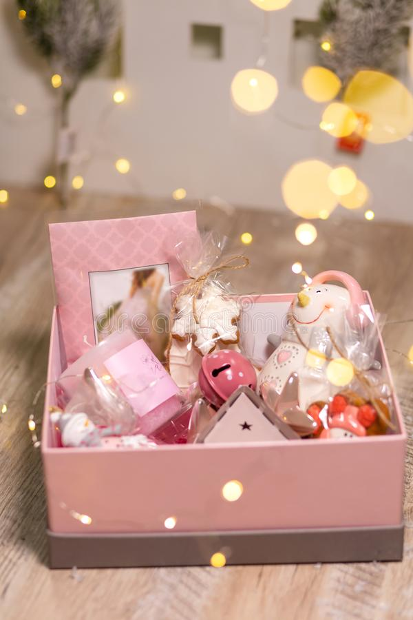Box with Christmas holiday decorations. Christmas tree toys and decor items to create coziness.  stock photos