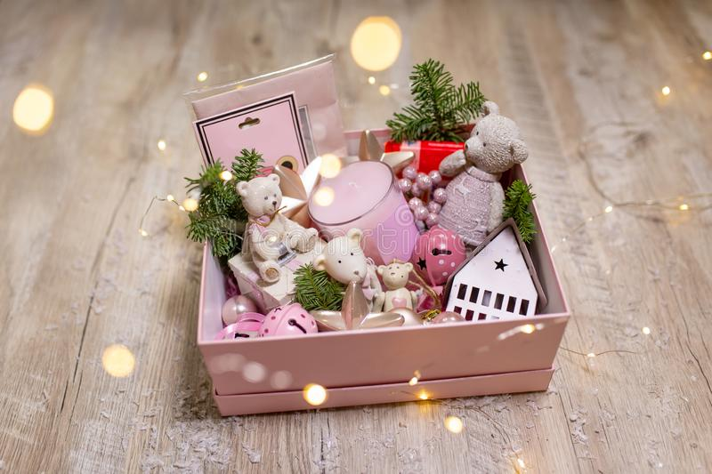 Box with Christmas holiday decorations. Christmas tree toys and decor items to create coziness.  stock images