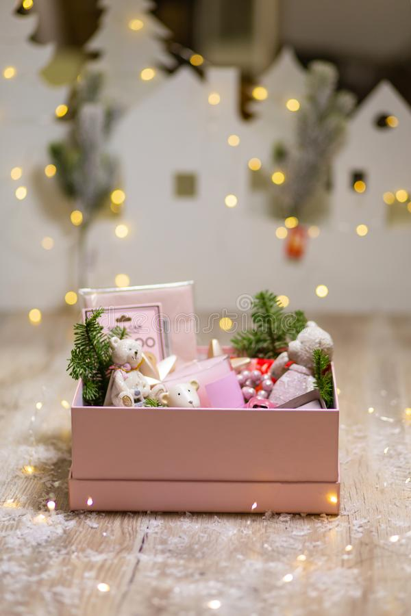 Box with Christmas holiday decorations. Christmas tree toys and decor items to create coziness.  royalty free stock photo