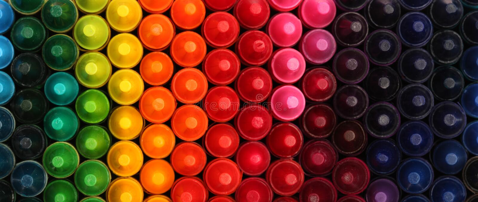 Box of crayons in a rainbow of colors. Background royalty free stock photo