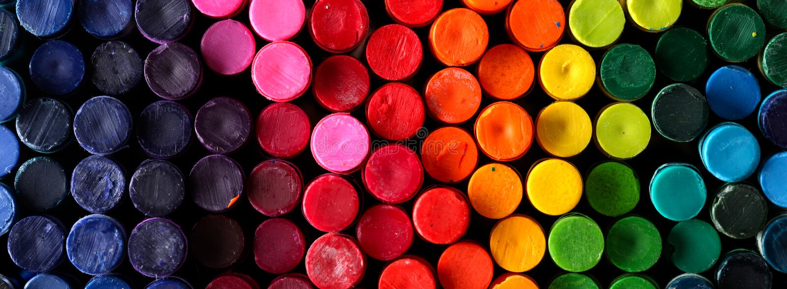 Box of crayons in a rainbow of colors. Background stock photography