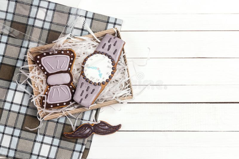 Box of delicious creative cookies with copy space on checkered napkin on white wooden table. Happy Father`s Day concept royalty free stock image