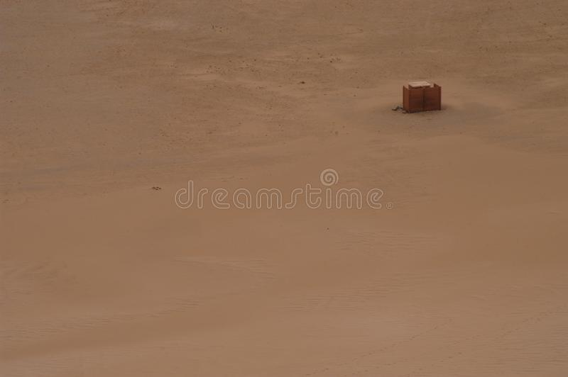 Box in desert royalty free stock image