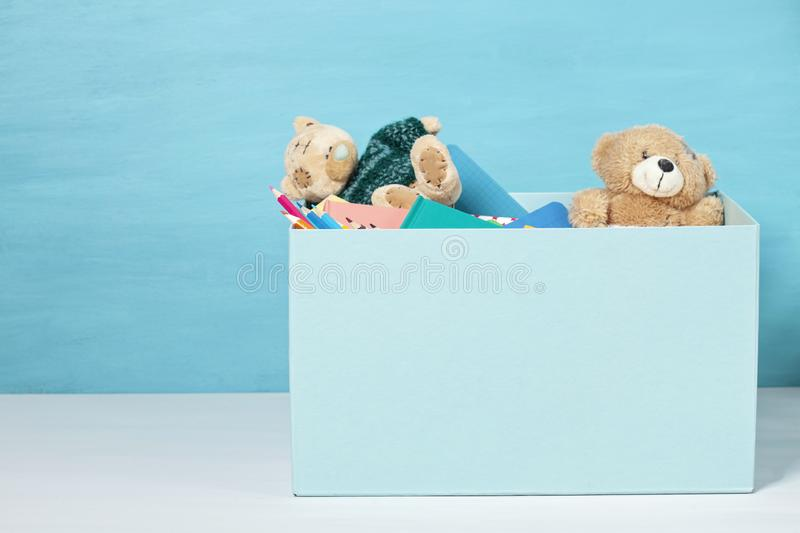 Box with donations for children with school supplies and toys royalty free stock image