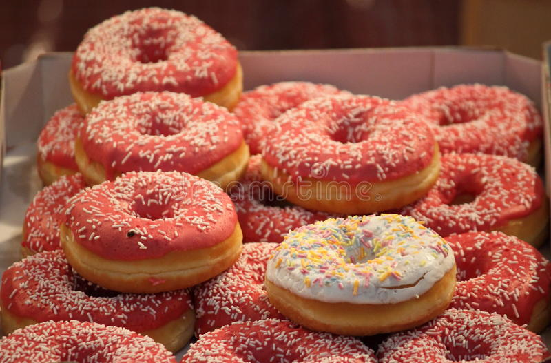 Box of donuts. Box of assorted colorful donuts stock photo