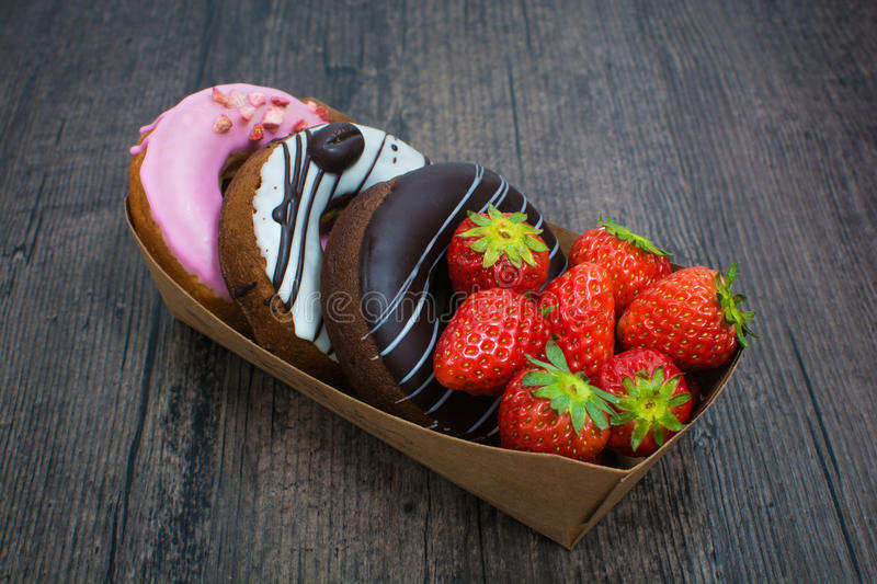 Box of donuts and strawberry stock photos