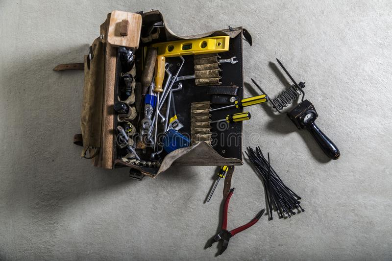 Box with electrician tools on leather background royalty free stock photos
