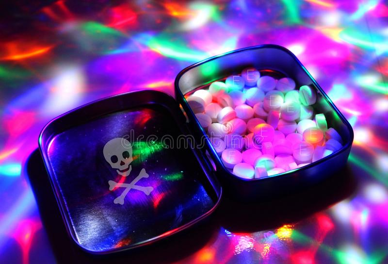 A box filled with ecstasy under disco lights. stock photos