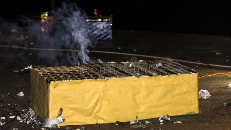 Box of fireworks. Smoldering after the light show royalty free stock photography
