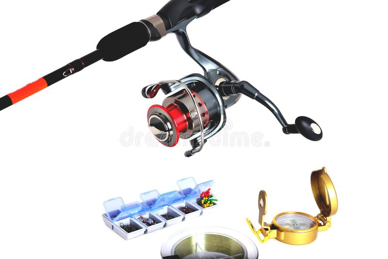 Box for fishing accessories, fishing reel, fishing rod, fishing feeders white background. Close-up stock photography