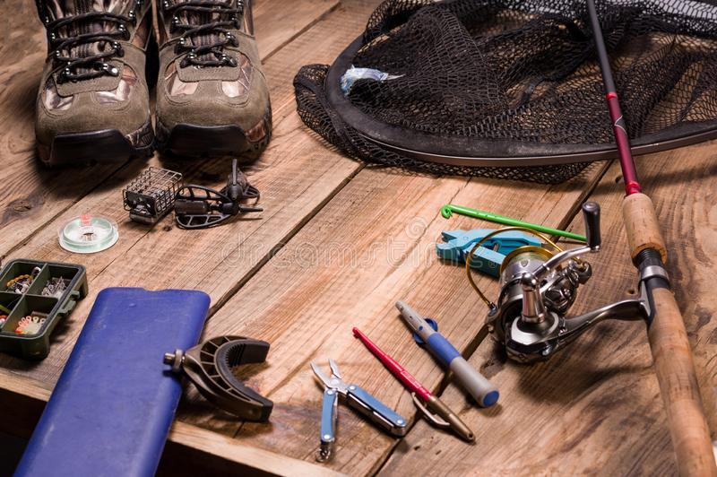 Box for fishing leashes. Fishing on feeder. Tools, shoes and fishing pole. Front view royalty free stock image