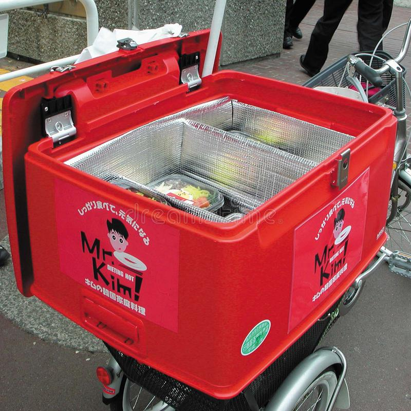 Box for food delivery. Tokyo, Japan - February 23, 2002: Box for food delivery on a bike royalty free stock photography