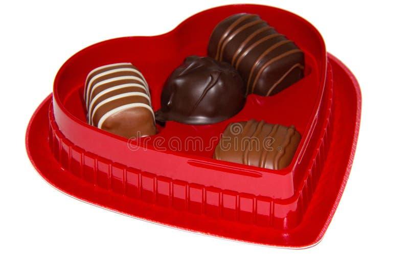 box formad chokladhjärta arkivbilder
