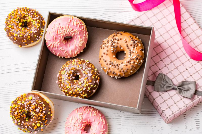 A box with fresh homemade donuts with various toppings. stock image